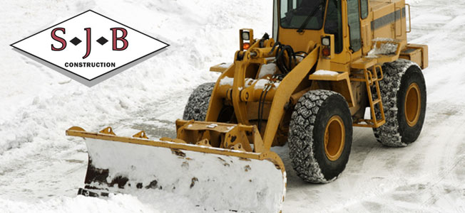 Snow plowing parking lots in Central Mass.- SJB Construction